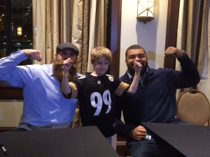 Cam and Brett Keisel with their tough guy buddy. Anthony. Photo: Teresa Varley